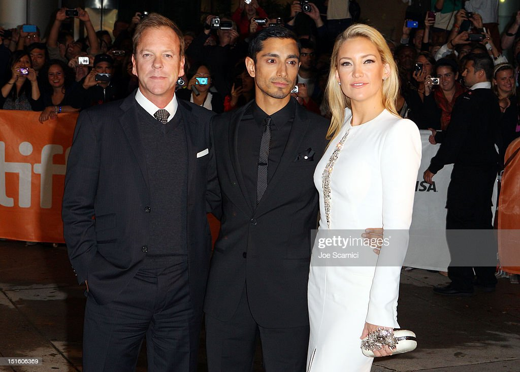 Actors <a gi-track='captionPersonalityLinkClicked' href=/galleries/search?phrase=Kiefer+Sutherland&family=editorial&specificpeople=203142 ng-click='$event.stopPropagation()'>Kiefer Sutherland</a>, Riz Ahmed and <a gi-track='captionPersonalityLinkClicked' href=/galleries/search?phrase=Kate+Hudson&family=editorial&specificpeople=156407 ng-click='$event.stopPropagation()'>Kate Hudson</a> attend 'The Reluctant Fundamentalist' premiere during the 2012 Toronto International Film Festival at Roy Thomson Hall on September 8, 2012 in Toronto, Canada.
