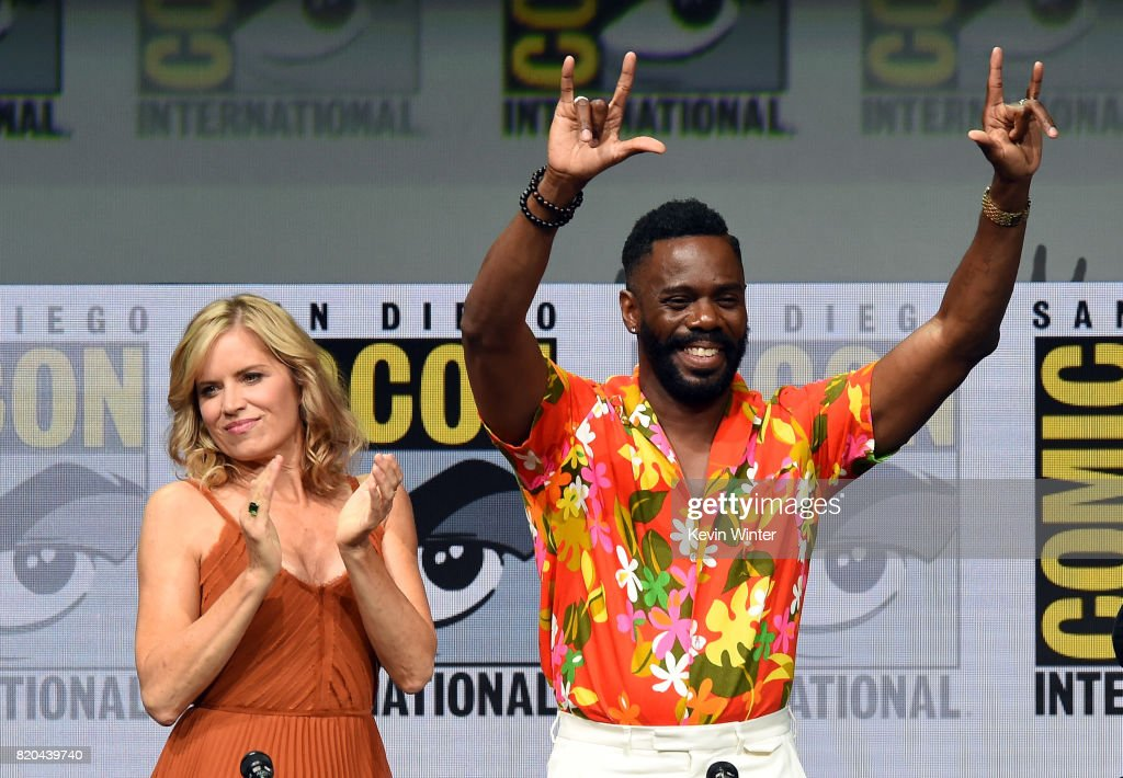 Actors Kim Dickens (L) and Colman Domingo walk onstage at Comic-Con International 2017 AMC's 'Fear The Walking Dead' Panel at San Diego Convention Center on July 21, 2017 in San Diego, California.