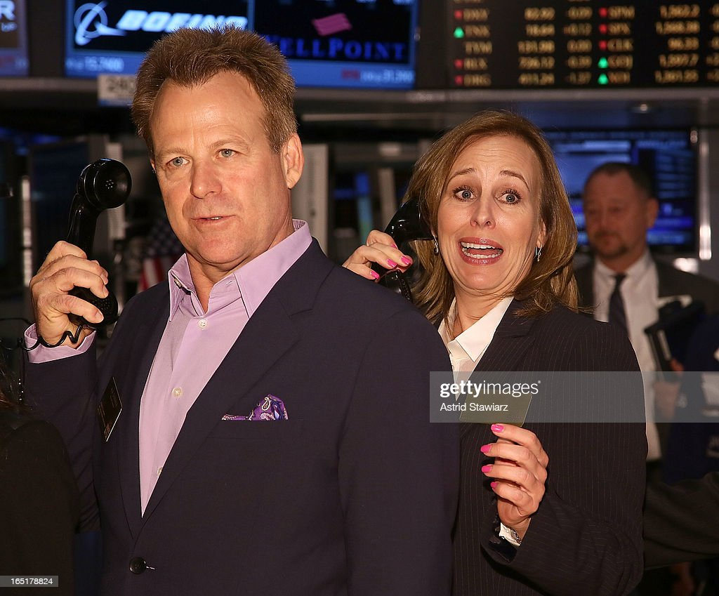 Actors Kin Shriner and Genie Francis of ABC's soap opera General Hospital ring the opening bell at the New York Stock Exchange on April 1, 2013 in New York City.