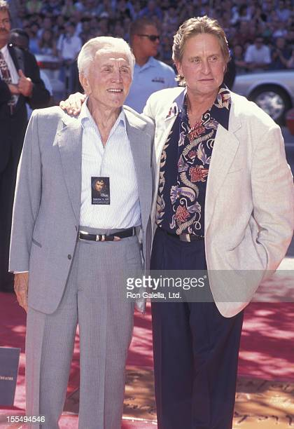 Actors Kirk Douglas and Michael Douglas attend Michael Douglas Hand And Footprint Ceremony on September 10 1997 at Mann Chinese Theater in Hollywood...