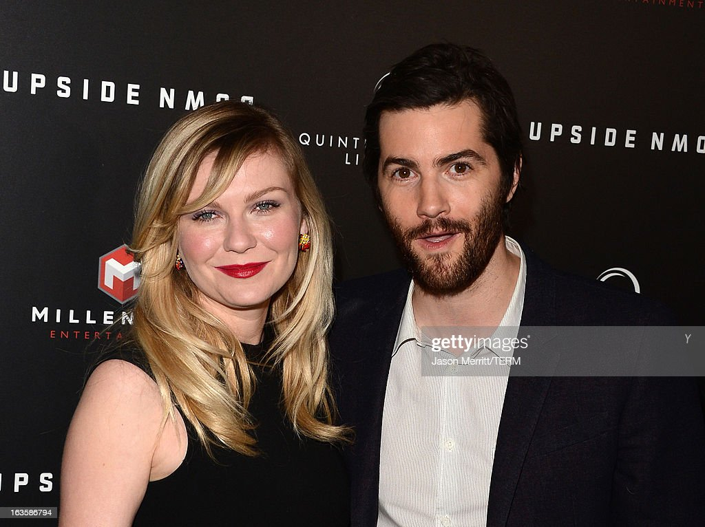 Actors <a gi-track='captionPersonalityLinkClicked' href=/galleries/search?phrase=Kirsten+Dunst&family=editorial&specificpeople=171590 ng-click='$event.stopPropagation()'>Kirsten Dunst</a> (L) and <a gi-track='captionPersonalityLinkClicked' href=/galleries/search?phrase=Jim+Sturgess&family=editorial&specificpeople=4489740 ng-click='$event.stopPropagation()'>Jim Sturgess</a> arrive at a special LA screening of Millennium Entertainment's 'Upside Down' at ArcLight Hollywood on March 12, 2013 in Hollywood, California.