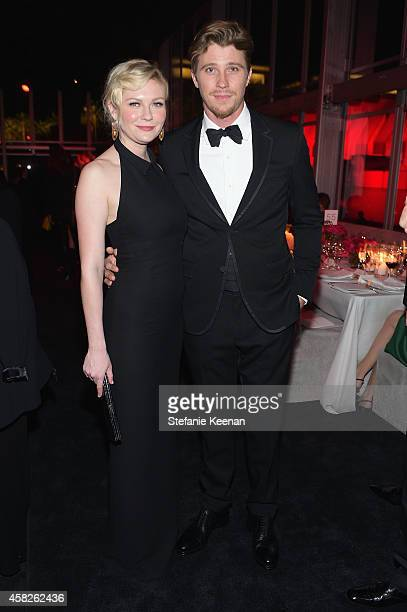 Actors Kirsten Dunst wearing Gucci and Garrett Hedlund wearing Gucci attend the 2014 LACMA Art Film Gala honoring Barbara Kruger and Quentin...