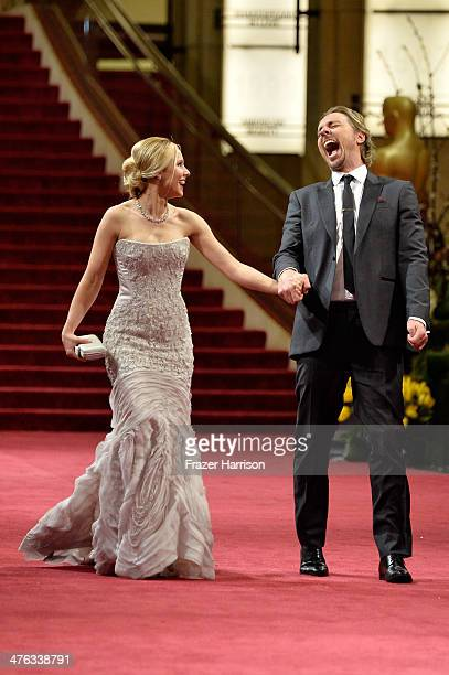 Actors Kristen Bell and Dax Shepard depart the Oscars at Hollywood Highland Center on March 2 2014 in Hollywood California