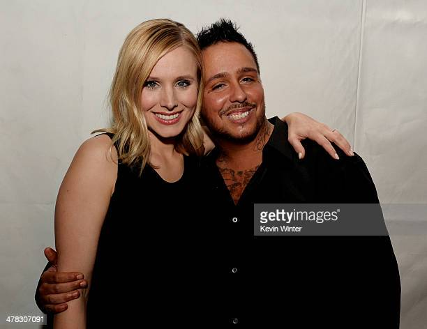 Actors Kristen Bell and Francis Capra pose at the after party for the premiere of 'Veronica Mars' at Sadies Kitchen on March 12 2014 in Los Angeles...