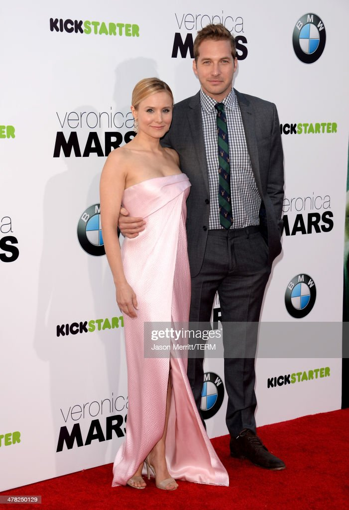 Actors Kristen Bell (L) and Ryan Hansen arrive at the Los Angeles premiere of 'Veronica Mars' at TCL Chinese Theatre on March 12, 2014 in Hollywood, California.