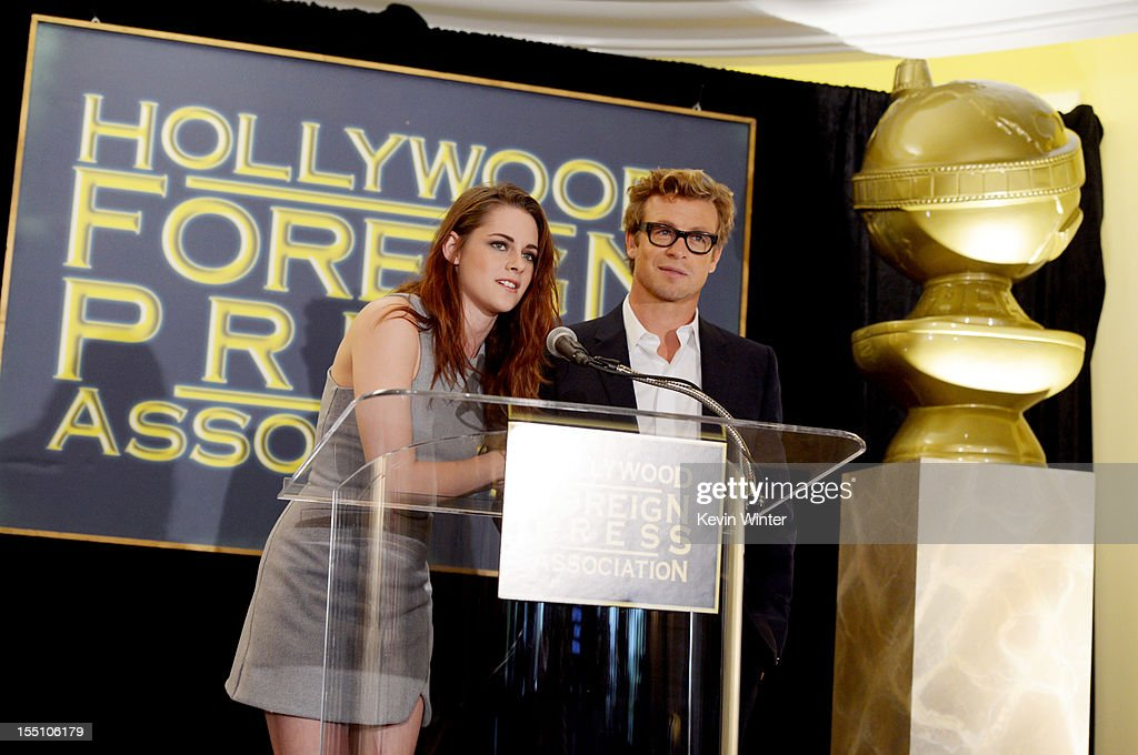 Actors Kristen Stewart (L) and Simon Baker speak at the Hollywood Foreign Press Association's announcement of Jodie Foster as the recipient of the Cecil B. DeMille Award at the Beverly Hills Hotel on November 1, 2012 in Beverly Hills, California.