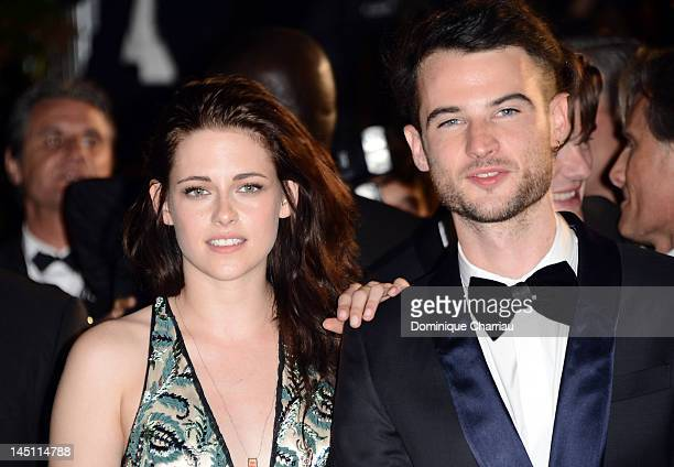 Actors Kristen Stewart and Tom Sturridge depart the 'On The Road' Premiere during the 65th Annual Cannes Film Festival at Palais des Festivals on May...
