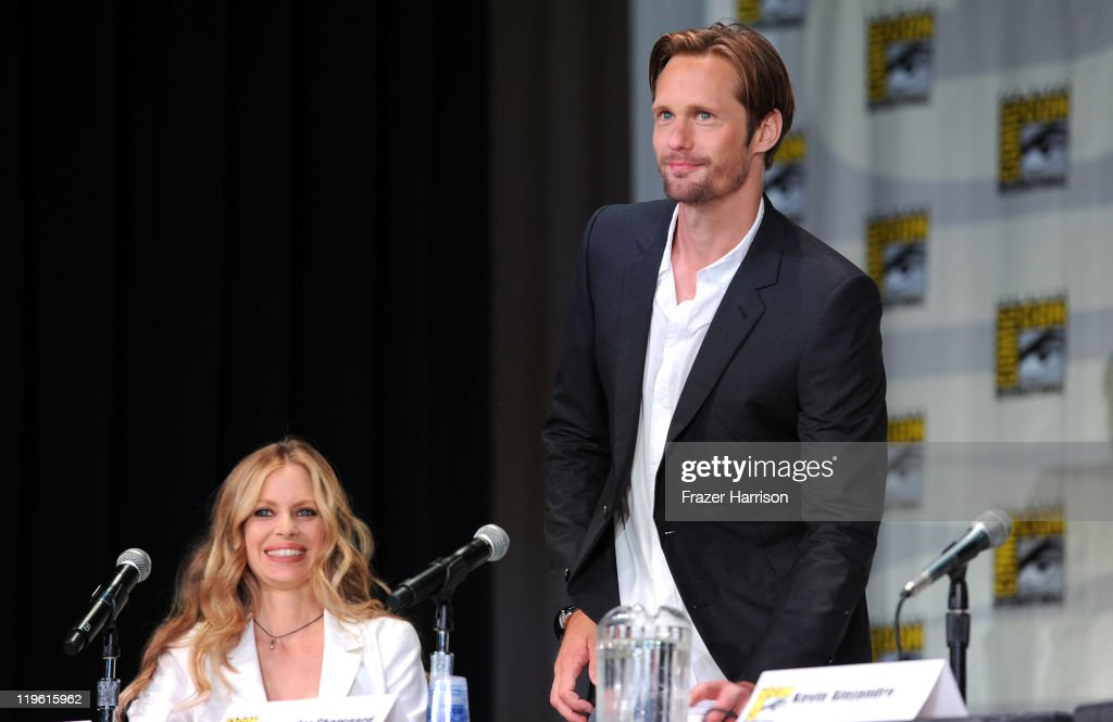 Actors <a gi-track='captionPersonalityLinkClicked' href=/galleries/search?phrase=Kristin+Bauer&family=editorial&specificpeople=3164038 ng-click='$event.stopPropagation()'>Kristin Bauer</a> and Alexander Skarsgard speak at HBO's 'True Blood' Panel during Comic-Con 2011 and the San Diego Convention Center on July 22, 2011 in San Diego, California.