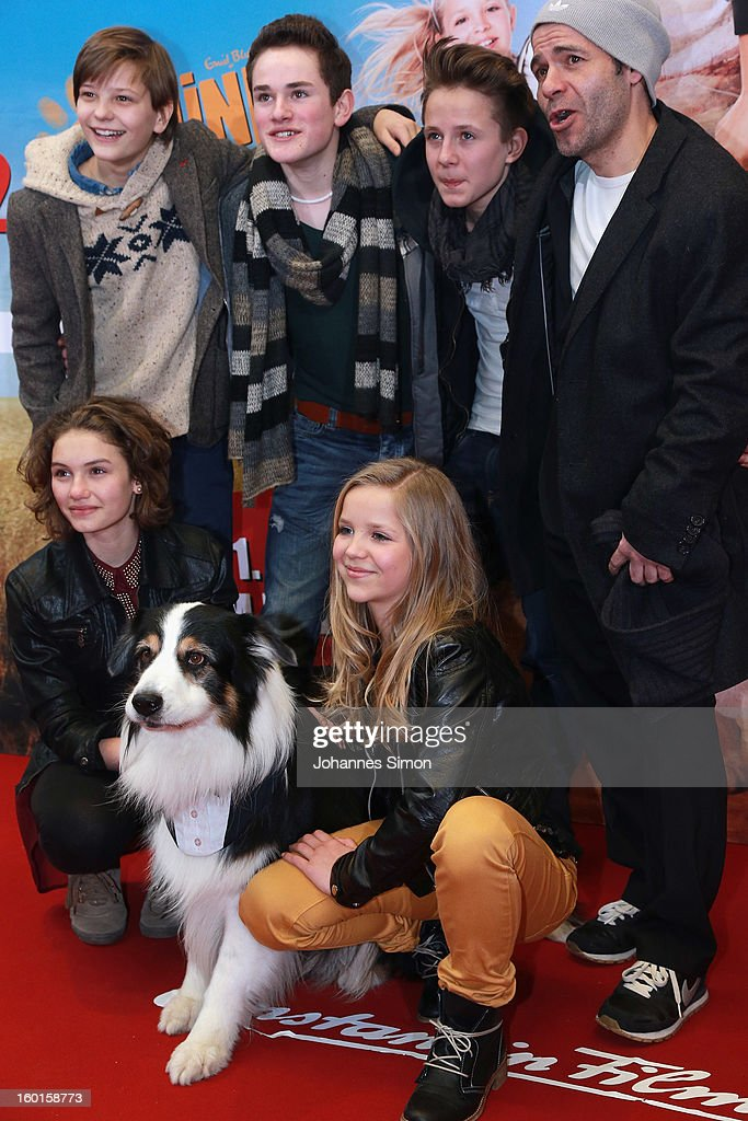 Actors (Back Row L-R) Kristo Ferkic, Quirin Oettl, Justus Schlingensiepen and director Mike Marzuk and (Front Row L-R) Valeria Eisenbart, dog Coffey and Neele Marie Nickel arrive for the 'Fuenf Freunde 2' movie premiere at CineMaxx Cinema on January 27, 2013 in Munich, Germany.