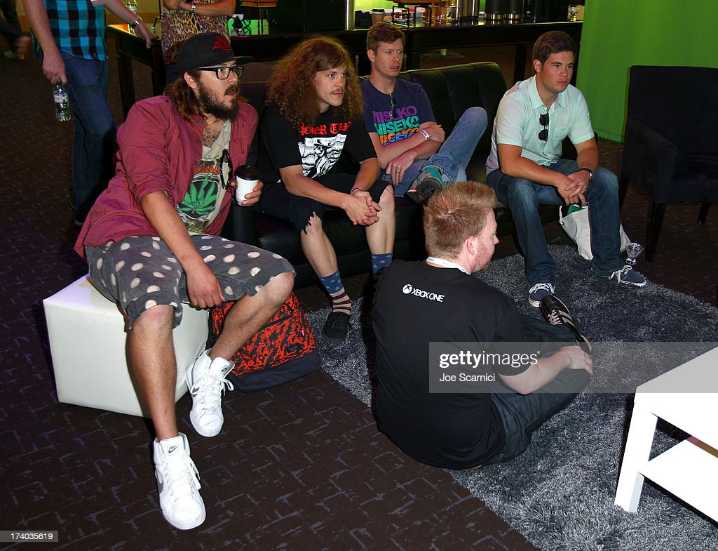 Actors Kyle Newacheck, Blake Anderson, Anders Holm and Adam DeVine play Xbox One at Comic-Con 2013 at the Hard Rock Hotel San Diego on July 19, 2013 in San Diego, California.