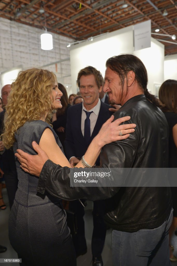 Actors <a gi-track='captionPersonalityLinkClicked' href=/galleries/search?phrase=Kyra+Sedgwick&family=editorial&specificpeople=202514 ng-click='$event.stopPropagation()'>Kyra Sedgwick</a>, <a gi-track='captionPersonalityLinkClicked' href=/galleries/search?phrase=Kevin+Bacon&family=editorial&specificpeople=202000 ng-click='$event.stopPropagation()'>Kevin Bacon</a> and Founder, Chief Executive Officer and Chairman of the Board of J/P Haitian Relief Organization <a gi-track='captionPersonalityLinkClicked' href=/galleries/search?phrase=Sean+Penn&family=editorial&specificpeople=202979 ng-click='$event.stopPropagation()'>Sean Penn</a> attend Giorgio Armani Paris Photo LA Acqua #3 at Paramount Studios on April 25, 2013 in Los Angeles, California.