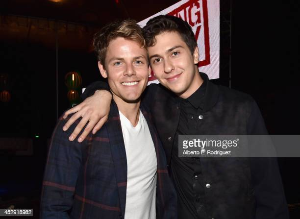 Actors Lachlan Buchanan and Nat Wolff attend the after party for the premiere of Mad Chance's 'Behaving Badly' at Lure on July 29 2014 in Hollywood...