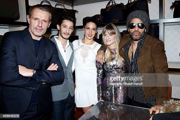 Actors Lambert Wilson Pierre Niney his Fiance Natasha Andrews Melanie Laurent and singer Lenny Kravitz attend the Longchamp Elysees 'Lights On Party'...