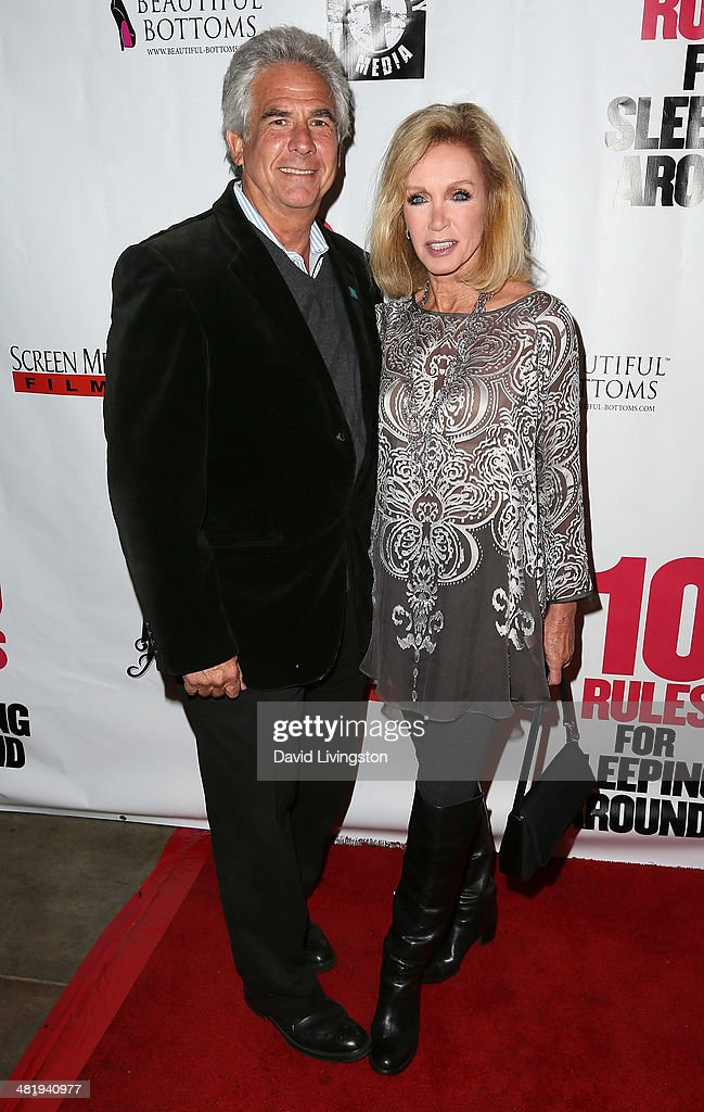 Actors Larry Gilman (L) and <a gi-track='captionPersonalityLinkClicked' href=/galleries/search?phrase=Donna+Mills&family=editorial&specificpeople=217252 ng-click='$event.stopPropagation()'>Donna Mills</a> attend the premiere of Screen Media Films' '10 Rules for Sleeping Around' at the Egyptian Theatre on April 1, 2014 in Hollywood, California.