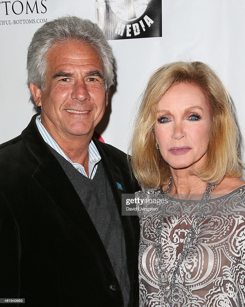 Actors Larry Gilman (L) and Donna Mills attend the premiere of Screen Media Films' '10 Rules for Sleeping Around' at the Egyptian Theatre on April 1, 2014 in Hollywood, California.