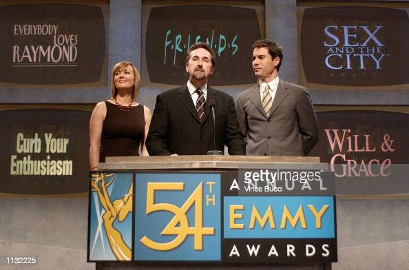 Actors Laura Innes and Eric McCormack listen as Academy president Bryce Zabel helps to announce the nominations for best comedy series for the 54th...