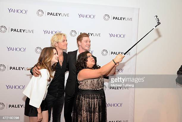 Actors Laura Marano Ross Lynch Calum Worthy and Raini Rodriguez take a group selfie at a special screening of Disney Channel's 'Austin Ally' as part...