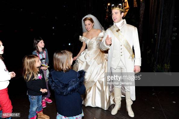 Actors Laura Osnes and Santino Fontana of Broadway's 'Cinderella' pose with cast members from 'Duck Dynasty' at Broadway Theatre on November 26 2013...