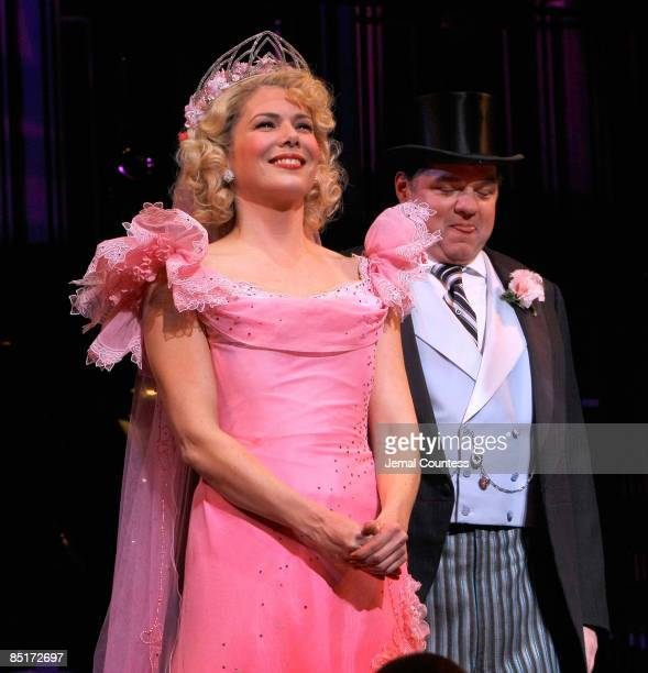 Actors Lauren Graham and Oliver Platt take a bow during curatin call at the opening night of 'Guys Dolls' on Broadway at the Nederlander Theatre on...