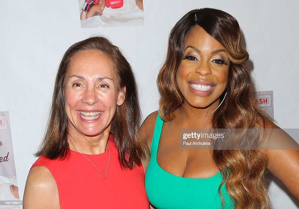 Actors Lauren Metcalf (L) and <a gi-track='captionPersonalityLinkClicked' href=/galleries/search?phrase=Niecy+Nash&family=editorial&specificpeople=228464 ng-click='$event.stopPropagation()'>Niecy Nash</a> (R) attend the release party for <a gi-track='captionPersonalityLinkClicked' href=/galleries/search?phrase=Niecy+Nash&family=editorial&specificpeople=228464 ng-click='$event.stopPropagation()'>Niecy Nash</a> new book 'It's Hard To Fight Naked' at the Luxe Rodeo Drive Hotel on May 14, 2013 in Beverly Hills, California.