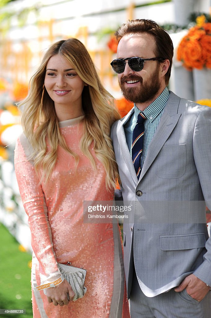 Actors Lauren Parsekian and Aaron Paul attend the seventh annual Veuve Clicquot Polo Classic in Liberty State Park on May 31 2014 in Jersey City City