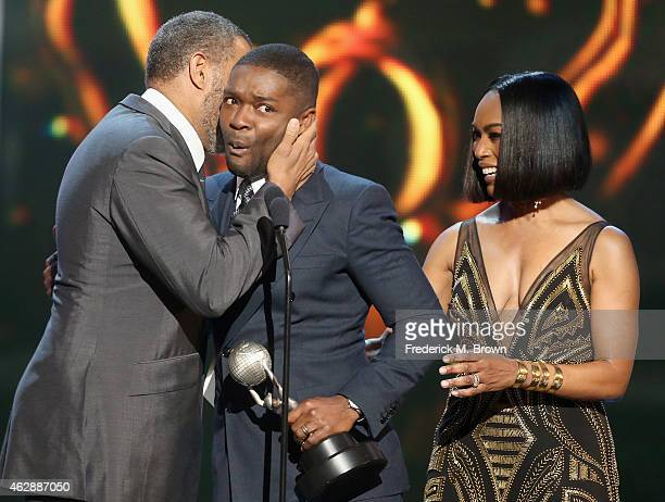 Actors Laurence Fishburne and Angela Bassett present the award for Outstanding Actor in a Motion Picture for 'Selma' to actor David Oyelowo onstage...
