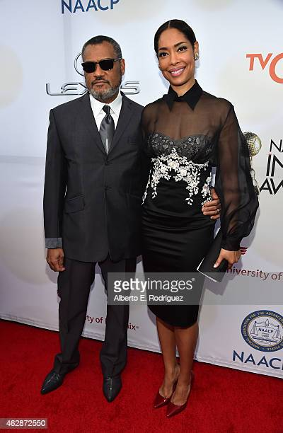 Actors Laurence Fishburne and Gina Torres attend the 46th NAACP Image Awards presented by TV One at Pasadena Civic Auditorium on February 6 2015 in...