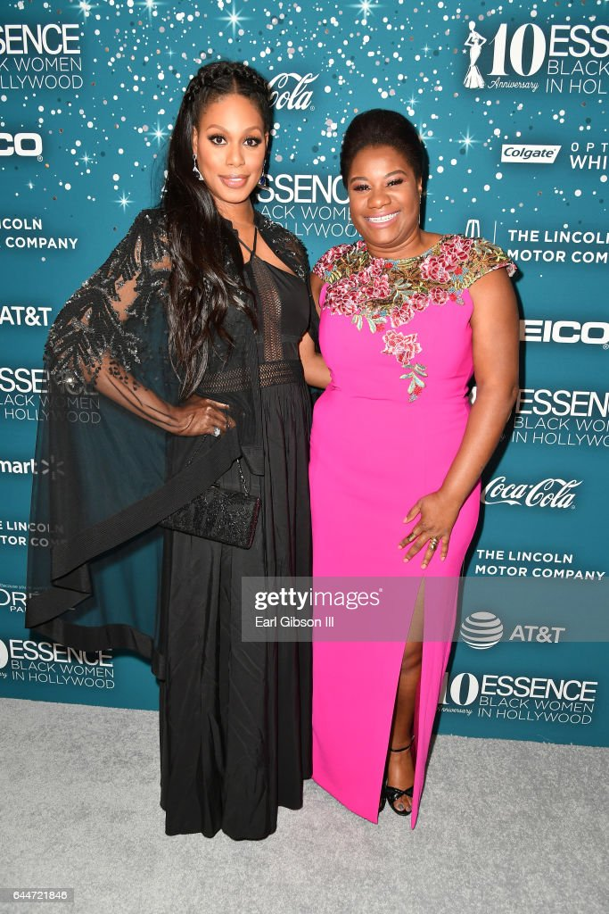 Actors Laverne Cox (L) and Adrienne C. Moore at Essence Black Women in Hollywood Awards at the Beverly Wilshire Four Seasons Hotel on February 23, 2017 in Beverly Hills, California.