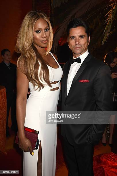 Actors Laverne Cox and John Stamos attend HBO's Official 2015 Emmy After Party at The Plaza at the Pacific Design Center on September 20 2015 in Los...