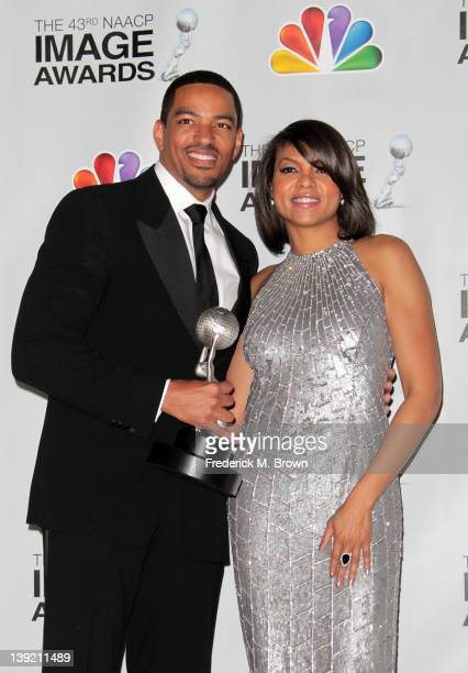 Actors Laz Alonzo and Taraji P Henson pose with the award for Outstanding Actor in a Motion Picture for 'Jumping the Broom' in the press room at the...