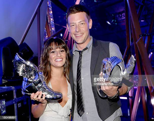 Actors Lea Michele and Cory Monteith pose with awards at the 2012 Do Something Awards at Barker Hangar on August 19 2012 in Santa Monica California