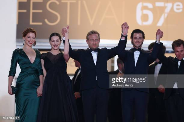 Actors Lea Seydoux Amira Cesar Jeremie Renier Gaspard Ulliel and director Bertrand Bonello leave the 'Saint Laurent' premiere during the 67th Annual...