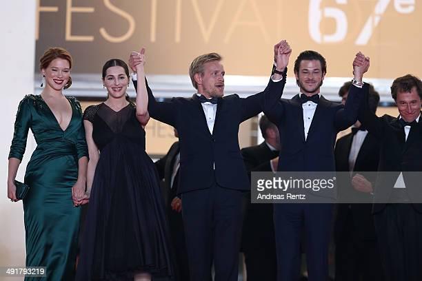 Actors Lea Seydoux Amira Cesar Jeremie Renier Gaspard Ulliel and director Bertrand Bonello leave the 'Saint Laurent' premiere during the 67th Annual...