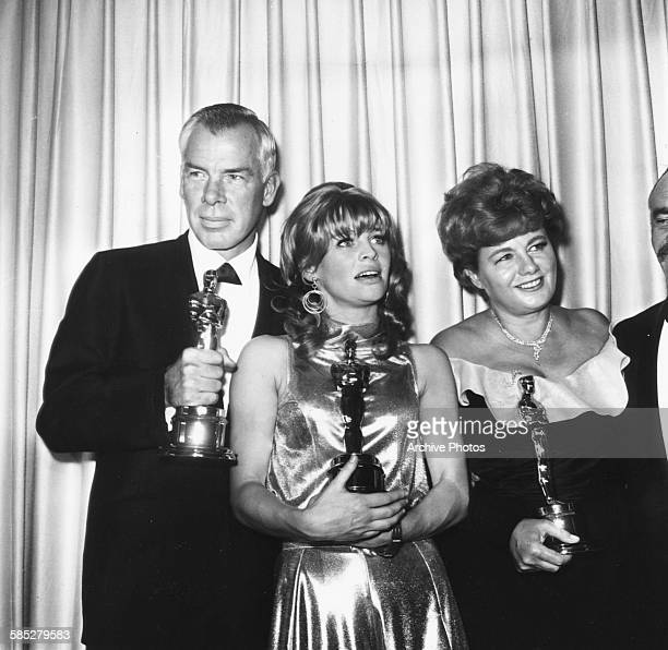Actors Lee Marvin Julie Christie and Shelley Winter holding their acting Oscars at the 38th Academy Awards Los Angeles April 18th 1966