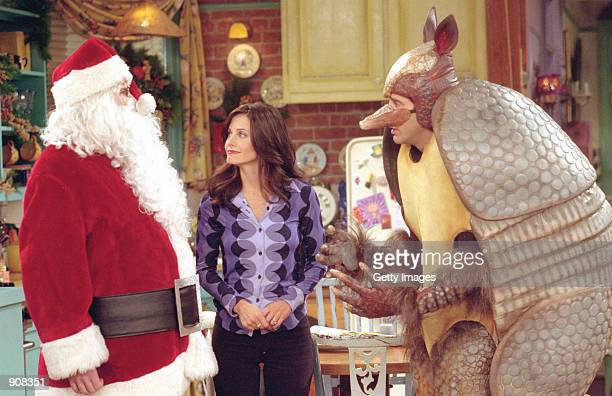 Actors left to right Matthew Perry as Chandler Bing Courteney Cox Arquette as Monica Geller and David Schwimmer as Ross Geller star in NBC's comedy...