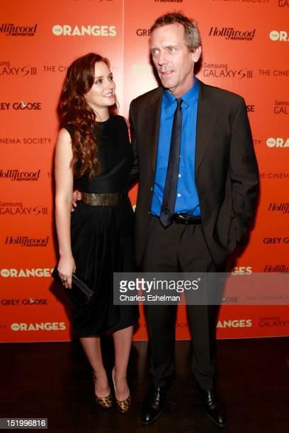 Actors Leighton Meester and Hugh Laurie attend The Cinema Society with The Hollywood Reporter Samsung Galaxy S III host a screening of 'The Oranges'...