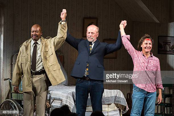 Actors Leon Addison Brown Bruce Willis and Laurie Metcalf on stage for curtain call during 'Misery' Broadway opening night at The Broadhurst Theatre...