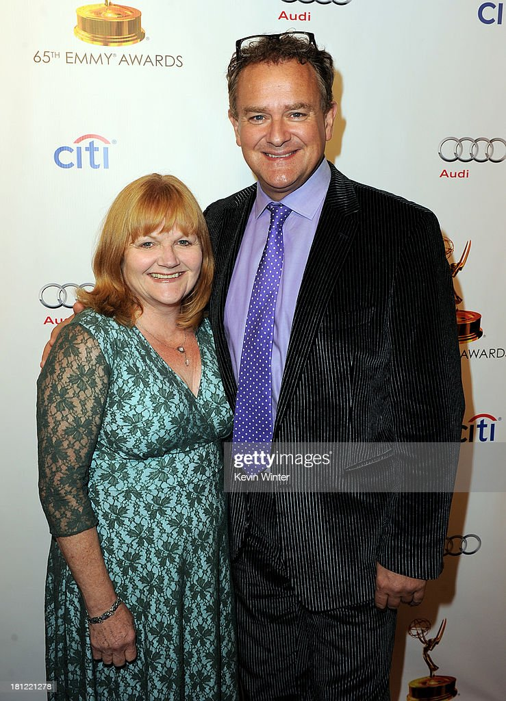 Actors Lesley Nicol (L) and <a gi-track='captionPersonalityLinkClicked' href=/galleries/search?phrase=Hugh+Bonneville&family=editorial&specificpeople=228840 ng-click='$event.stopPropagation()'>Hugh Bonneville</a> arrive at the 65th Primetime Emmy Awards Writer Nominees reception at the Academy of Television Arts & Sciences on September 19, 2013 in No. Hollywood, California.
