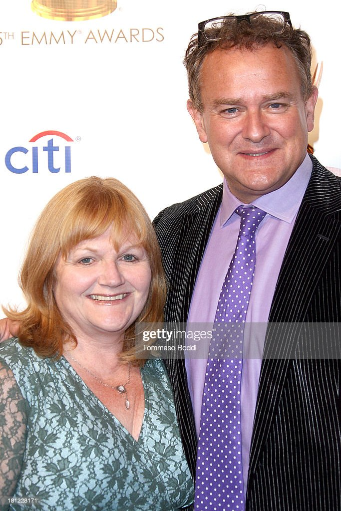Actors Lesley Nicol (L) and <a gi-track='captionPersonalityLinkClicked' href=/galleries/search?phrase=Hugh+Bonneville&family=editorial&specificpeople=228840 ng-click='$event.stopPropagation()'>Hugh Bonneville</a> attend the 65th Emmy Awards Writers Nominee reception held at the Leonard H. Goldenson Theatre on September 19, 2013 in North Hollywood, California.
