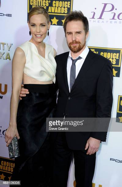 Actors Leslie Bibb and Sam Rockwell attend the 19th Annual Critics' Choice Movie Awards at Barker Hangar on January 16 2014 in Santa Monica California