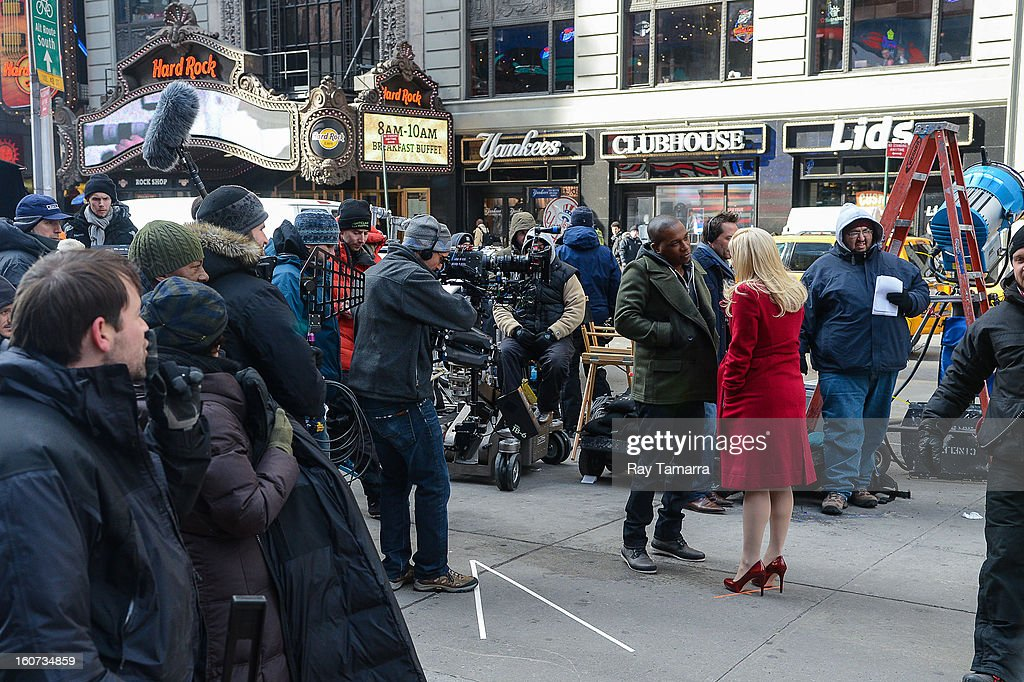 Actors Leslie Odom Jr. (L) and Megan Hilty film a scene at the 'Smash' movies poster at Times Square on February 4, 2013 in New York Citys
