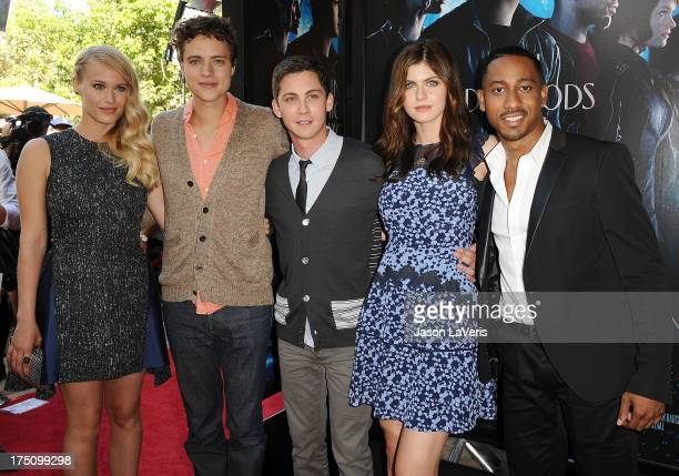 Actors Leven Rambin Douglas Smith Logan Lerman Alexandra Daddario and Brandon T Jackson attend the premiere of 'Percy Jackson Sea Of Monsters' at The...