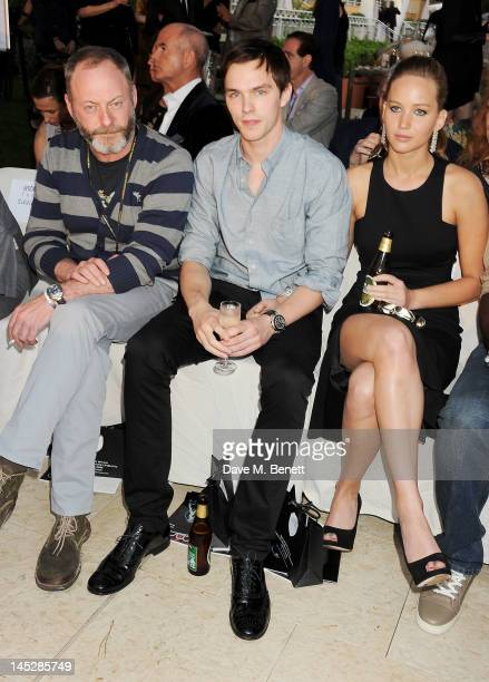 Actors Liam Cunningham Nicholas Hoult and Jennifer Lawrence attend a cocktail reception during Amber Lounge Fashion Monaco 2012 at Le Meridien Beach...