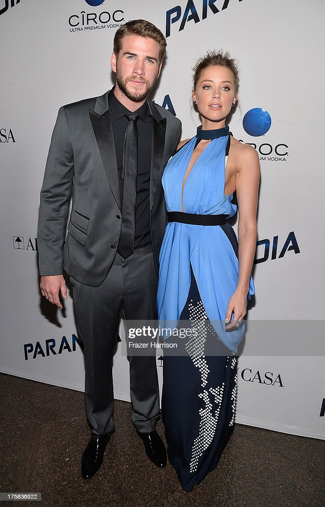Actors <a gi-track='captionPersonalityLinkClicked' href=/galleries/search?phrase=Liam+Hemsworth&family=editorial&specificpeople=6338547 ng-click='$event.stopPropagation()'>Liam Hemsworth</a> and <a gi-track='captionPersonalityLinkClicked' href=/galleries/search?phrase=Amber+Heard&family=editorial&specificpeople=2210577 ng-click='$event.stopPropagation()'>Amber Heard</a> attend the premiere of Relativity Media's 'Paranoia' at DGA Theater on August 8, 2013 in Los Angeles, California.