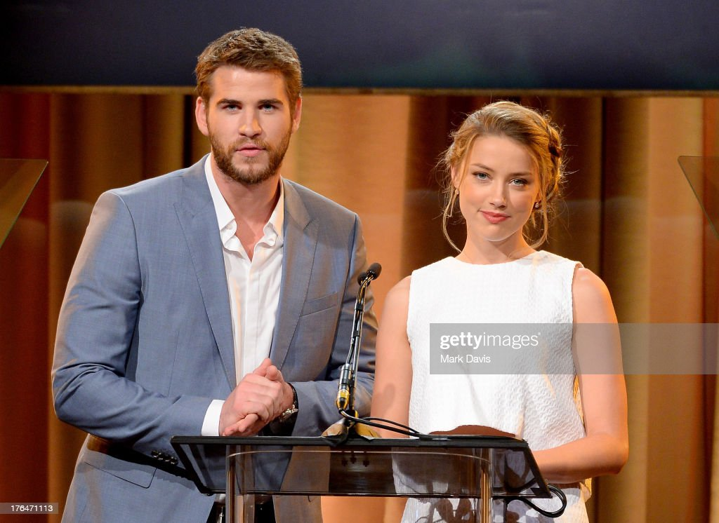 Actors <a gi-track='captionPersonalityLinkClicked' href=/galleries/search?phrase=Liam+Hemsworth&family=editorial&specificpeople=6338547 ng-click='$event.stopPropagation()'>Liam Hemsworth</a> and <a gi-track='captionPersonalityLinkClicked' href=/galleries/search?phrase=Amber+Heard&family=editorial&specificpeople=2210577 ng-click='$event.stopPropagation()'>Amber Heard</a> speak onstage at the Hollywood Foreign Press Association's 2013 Installation Luncheon at The Beverly Hilton Hotel on August 13, 2013 in Beverly Hills, California.
