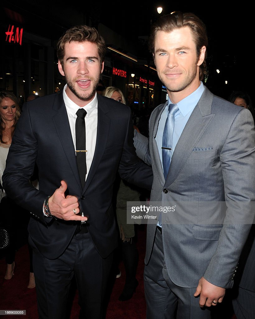 Actors <a gi-track='captionPersonalityLinkClicked' href=/galleries/search?phrase=Liam+Hemsworth&family=editorial&specificpeople=6338547 ng-click='$event.stopPropagation()'>Liam Hemsworth</a> (L) and <a gi-track='captionPersonalityLinkClicked' href=/galleries/search?phrase=Chris+Hemsworth&family=editorial&specificpeople=646776 ng-click='$event.stopPropagation()'>Chris Hemsworth</a> arrive at the premiere of Marvel's 'Thor: The Dark World' at the El Capitan Theatre on November 4, 2013 in Hollywood, California.