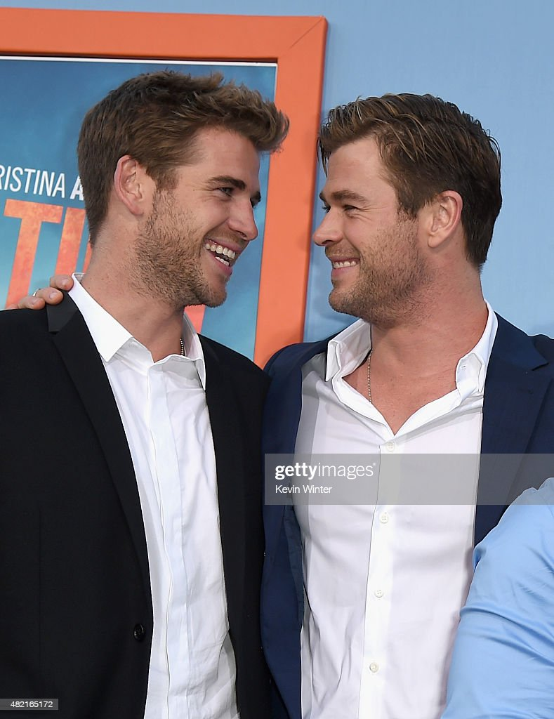 Actors Liam Hemsworth and Chris Hemsworth attend the premiere of Warner Bros Pictures 'Vacation' at Regency Village Theatre on July 27 2015 in...