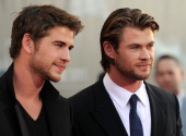 Actors Liam Hemsworth and his brother Chris Hemsworth arrive at the premiere of Thor in Hollywood California on May 2 2011 AFP PHOTO / GABRIEL BOUYS