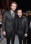 Actors Liam Hemsworth and Josh Hutcherson attend the premiere of Lionsgate's 'The Hunger Games Mockingjay Part 1' at Nokia Theatre LA Live on...