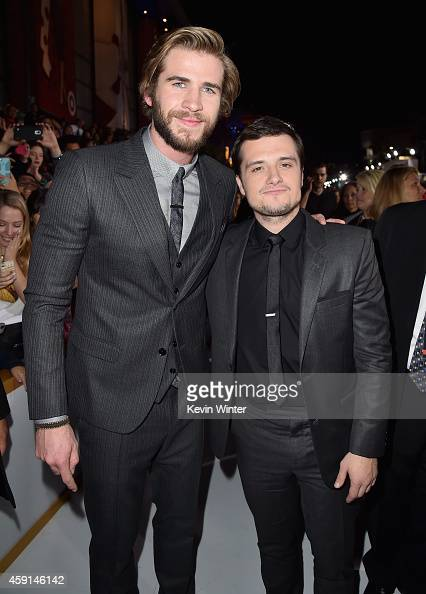 Actors Liam Hemsworth and Josh Hutcherson attend the premiere of Lionsgate's 'The Hunger Games Mockingjay Part 1' at Nokia Theatre LA Live on...